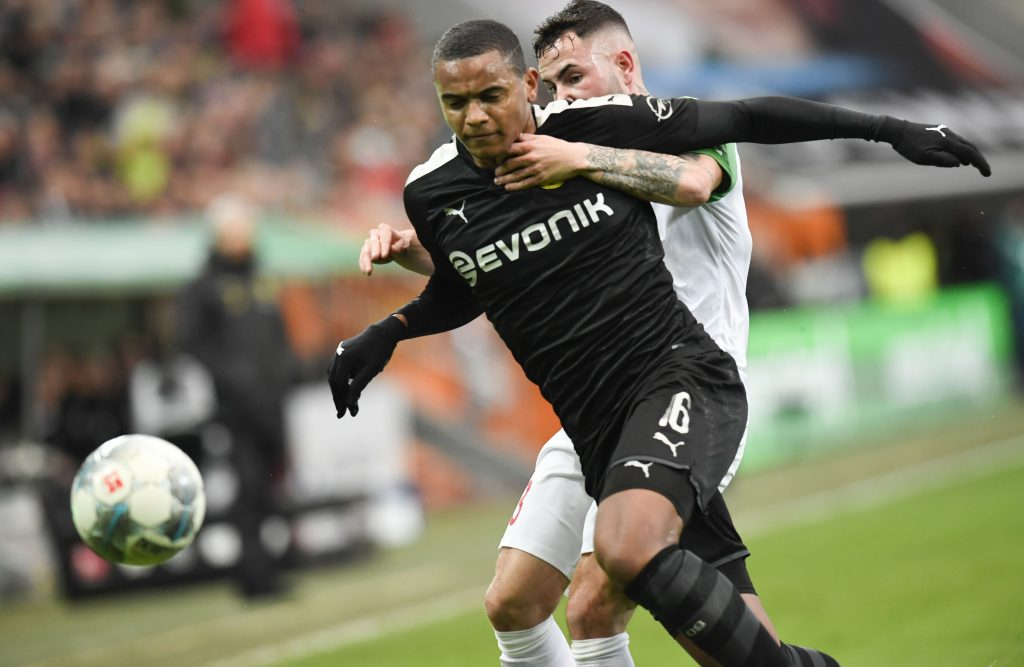 Augsburg's German midfielder Marco Richter (R) and Dortmund's Swiss defender Manuel Akanji vie for the ball during the German first division Bundesliga football match Augsburg v Borussia Dortmund in Augsburg, on January 18, 2020. (Photo by THOMAS KIENZLE / AFP) / DFL REGULATIONS PROHIBIT ANY USE OF PHOTOGRAPHS AS IMAGE SEQUENCES AND/OR QUASI-VIDEO (Photo by THOMAS KIENZLE/AFP via Getty Images)
