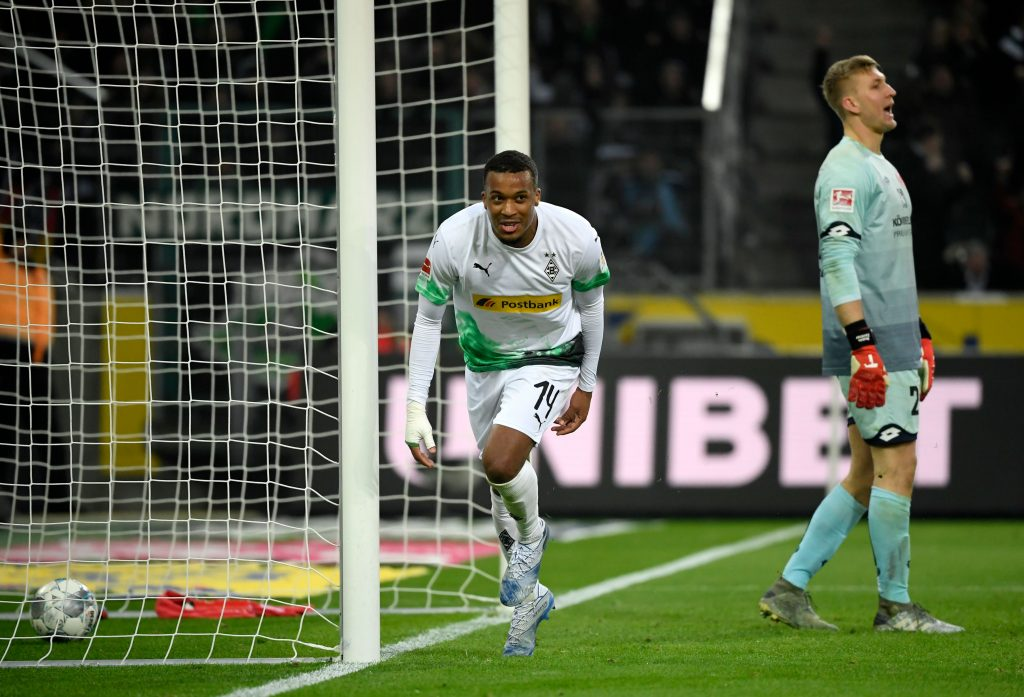 Moenchengladbach's French forward Alassane Plea reacts as he celebrates a goal during the German first division Bundesliga football match Borussia Moenchengladbach v Mainz 05 in Moenchengladbach on January 25, 2020. (Photo by INA FASSBENDER / AFP) / DFL REGULATIONS PROHIBIT ANY USE OF PHOTOGRAPHS AS IMAGE SEQUENCES AND/OR QUASI-VIDEO (Photo by INA FASSBENDER/AFP via Getty Images)