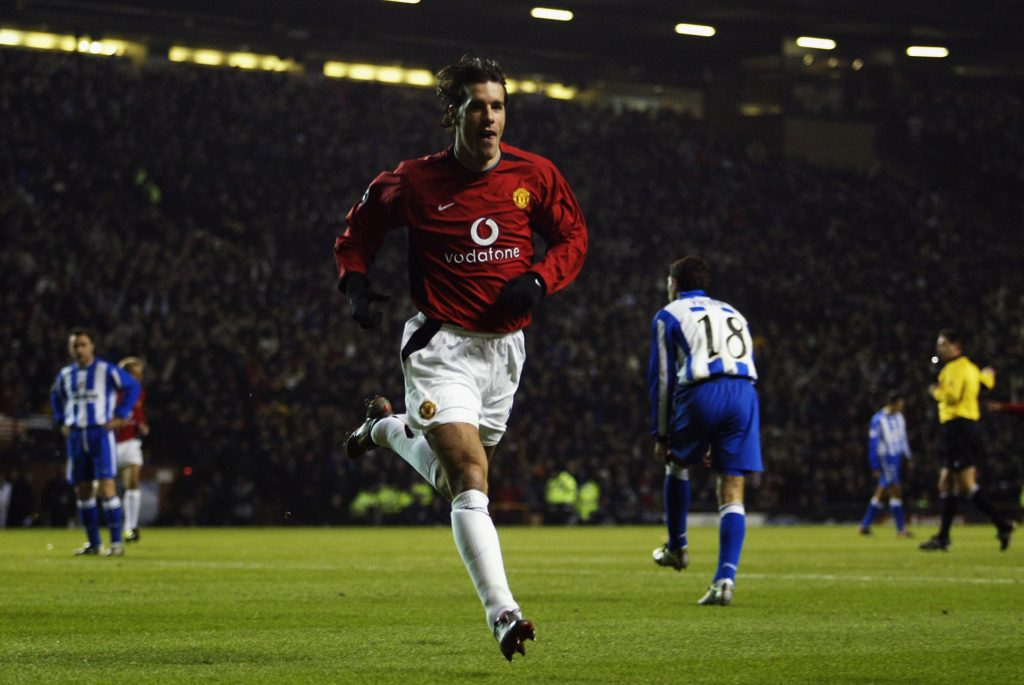 MANCHESTER - DECEMBER 11:  Ruud Van Nistelrooy of Manchester United celebrates after scoring his first goal during the Manchester United v Deportivo La Coruna UEFA Champions League, Phase 2, Group D match at Old Trafford on December 11, 2002 in Manchester, England.  Manchester United won the match 2-0. (Photo by Gary M. Prior/Getty Images)