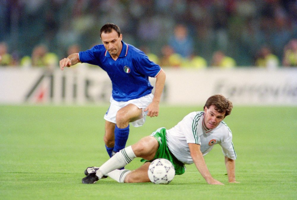 ROME, ITALY - JUNE 30: Republic of Ireland player Ray Houghton is challenged by Salvatore Schillaci during the 1990 FIFA World Cup quarter Final defeat against Italy at the Olympic Stadium on June 30, 1990 in Rome, Italy. (Photo by Allsport/Getty Images)