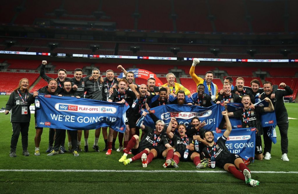 James Olayinka and the Northampton Town squad celebrating promotion at Wembley (Photo via NTFC on Twitter)