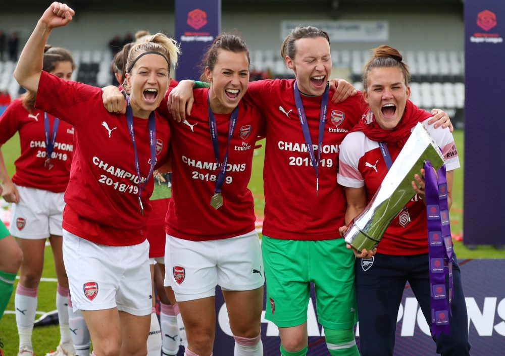 BOREHAMWOOD, ENGLAND - MAY 11:  Janni Arnth, Viki Schnaderbeck, Pauline Peyraud-Magnin and Katrine Veje celebrate with the trophy after the WSL match between Arsenal Women and Manchester City at Meadow Park on May 11, 2019 in Borehamwood, England. (Photo by Catherine Ivill/Getty Images)