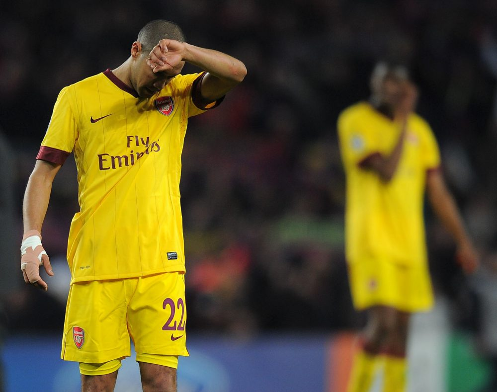 Arsenal's French player Gael Clichy gestures after lossig 3-1 their Champions League round of 16, 2nd leg football match FC Barcelona vs Arsenal on March 8, 2011 at Camp Nou stadium in Barcelona. AFP PHOTO / LLUIS GENE