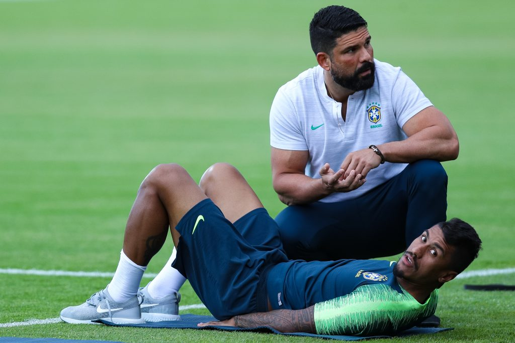 KAZAN, RUSSIA - JULY 05: Paulinho recovers with the physiotherapist Bruno Mazziotti during a Brazil training session ahead of the the 2018 FIFA World Cup Russia Quarter Final match between Brazil and Belgium at Tsentralny Stadium on July 5, 2018 in Kazan, Russia. (Photo by Buda Mendes/Getty Images)