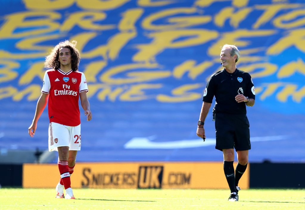 BRIGHTON, ENGLAND - JUNE 20: Referee Martin Atkinson speaks to Matteo Guendouzi of Arsenal during the Premier League match between Brighton & Hove Albion and Arsenal FC at American Express Community Stadium on June 20, 2020 in Brighton, England. Football Stadiums around Europe remain empty due to the Coronavirus Pandemic as Government social distancing laws prohibit fans inside venues resulting in all fixtures being played behind closed doors. (Photo by Gareth Fuller/Pool via Getty Images)