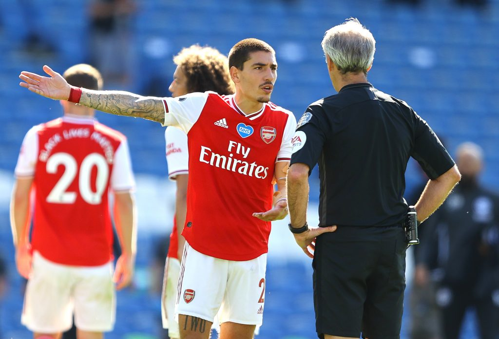 BRIGHTON, ENGLAND - JUNE 20: Hector Bellerin of Arsenal appeals to referee Martin Atkinson during the Premier League match between Brighton & Hove Albion and Arsenal FC at American Express Community Stadium on June 20, 2020 in Brighton, England. Football Stadiums around Europe remain empty due to the Coronavirus Pandemic as Government social distancing laws prohibit fans inside venues resulting in all fixtures being played behind closed doors. (Photo by Richard Heathcote/Getty Images)