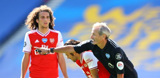 BRIGHTON, ENGLAND - JUNE 20: Referee Martin Atkinson awards a freekick to Arsenal during the Premier League match between Brighton & Hove Albion and Arsenal FC at American Express Community Stadium on June 20, 2020 in Brighton, England. (Photo by Richard Heathcote/Getty Images)