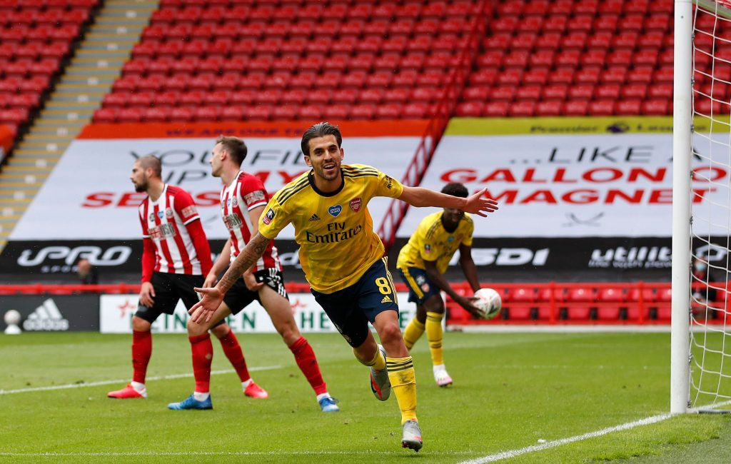 Arsenal's Spanish midfielder Dani Ceballos (C) runs to celebrate scoring a goal during the English FA Cup quarter-final football match between Sheffield United and Arsenal at Bramall Lane in Sheffield, northern England on June 28, 2020. (Photo by ANDREW BOYERS / POOL / AFP) / RESTRICTED TO EDITORIAL USE. No use with unauthorized audio, video, data, fixture lists, club/league logos or 'live' services. Online in-match use limited to 120 images. An additional 40 images may be used in extra time. No video emulation. Social media in-match use limited to 120 images. An additional 40 images may be used in extra time. No use in betting publications, games or single club/league/player publications. / (Photo by ANDREW BOYERS/POOL/AFP via Getty Images)