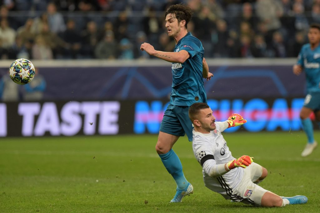 Zenit St. Petersburg's Iranian forward Sardar Azmoun challenges Lyon's Portuguese goalkeeper Anthony Lopes during the UEFA Champions League group G football match between Zenit and Lyon at the Gazprom Arena in Saint Petersburg on November 27, 2019. (Photo by Olga MALTSEVA / AFP)