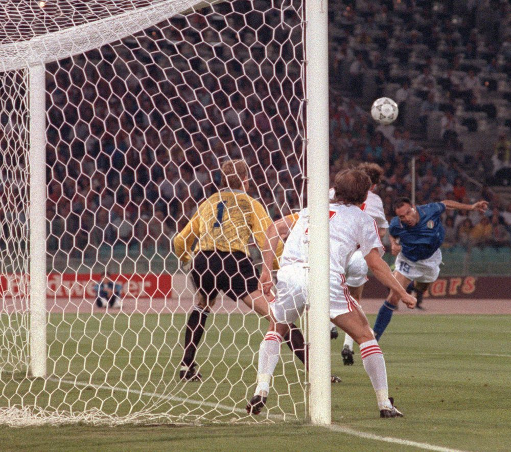 ROME, ITALY: Italian forward Salvatore Schillaci (R) scores his team's first goal on a header past Czech goalkeeper Jan Stejsk during the World Cup first round soccer match between Italy and Czechoslovakia 19 June 1990 in Rome. Italy won 2-0. AFP PHOTO/DANIEL GARCIA