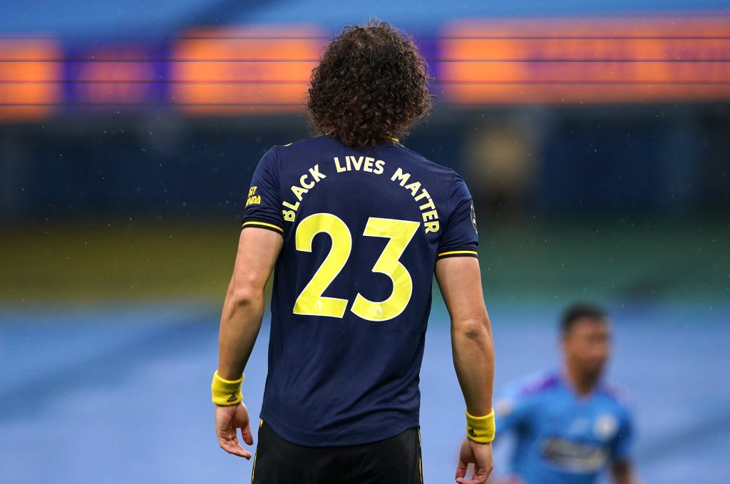 MANCHESTER, ENGLAND - JUNE 17: Black Lives Matter slogan is seen on the back of for David Luiz of Arsenal as he looks on during the Premier League match between Manchester City and Arsenal FC at Etihad Stadium on June 17, 2020 in Manchester, United Kingdom. (Photo by Dave Thompson/ Pool via Getty Images)
