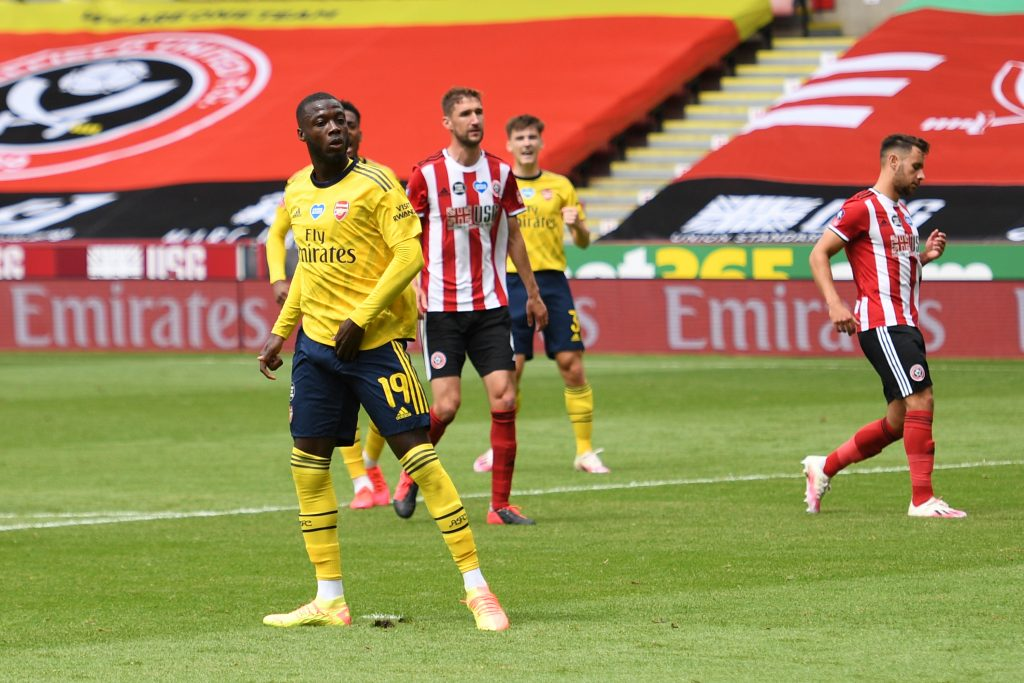 SHEFFIELD, ENGLAND - JUNE 28: Nicolas Pepe of Arsenal celebrates after scoring his teams first goal from the penalty spot during the FA Cup Fifth Quarter Final match between Sheffield United and Arsenal FC at Bramall Lane on June 28, 2020 in Sheffield, England. (Photo by Oli Scarff/Pool via Getty Images)