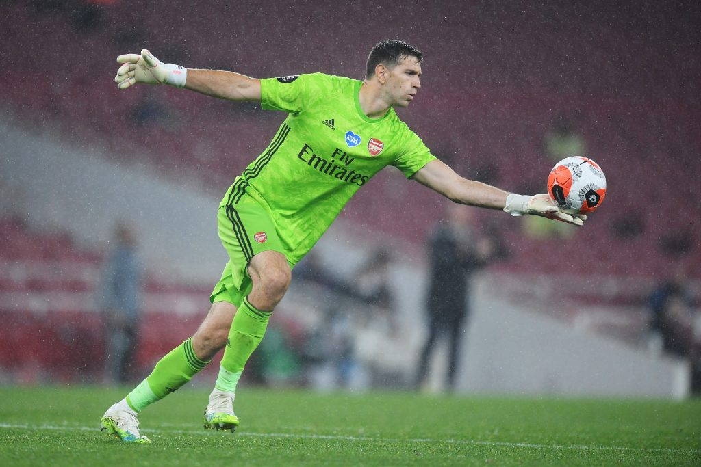 LONDON, ENGLAND - JULY 07: Emiliano Martinez of Arsenal takes a goal kick during the Premier League match between Arsenal FC and Leicester City at Emirates Stadium on July 07, 2020 in London, England. Football Stadiums around Europe remain empty due to the Coronavirus Pandemic as Government social distancing laws prohibit fans inside venues resulting in all fixtures being played behind closed doors. (Photo by Michael Regan/Getty Images)