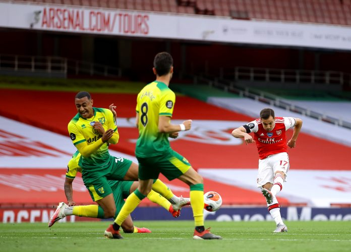 LONDON, ENGLAND - JULY 01: Cedric Soares of Arsenal shoots and scores his team's fourth goal during the Premier League match between Arsenal FC and Norwich City at Emirates Stadium on July 01, 2020 in London, England. Football Stadiums around Europe remain empty due to the Coronavirus Pandemic as Government social distancing laws prohibit fans inside venues resulting in all fixtures being played behind closed doors. (Photo by Richard Heathcote/Getty Images)