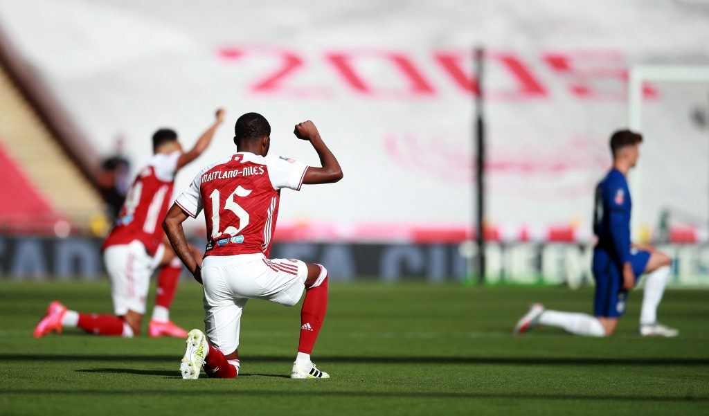 LONDON, ENGLAND - AUGUST 01: Ainsley Maitland-Niles of Arsenal takes a knee in support of the Black Lives Matter movement during the Heads Up FA Cup Final match between Arsenal and Chelsea at Wembley Stadium on August 01, 2020 in London, England. Football Stadiums around Europe remain empty due to the Coronavirus Pandemic as Government social distancing laws prohibit fans inside venues resulting in all fixtures being played behind closed doors. (Photo by Adam Davy/Pool via Getty Images)