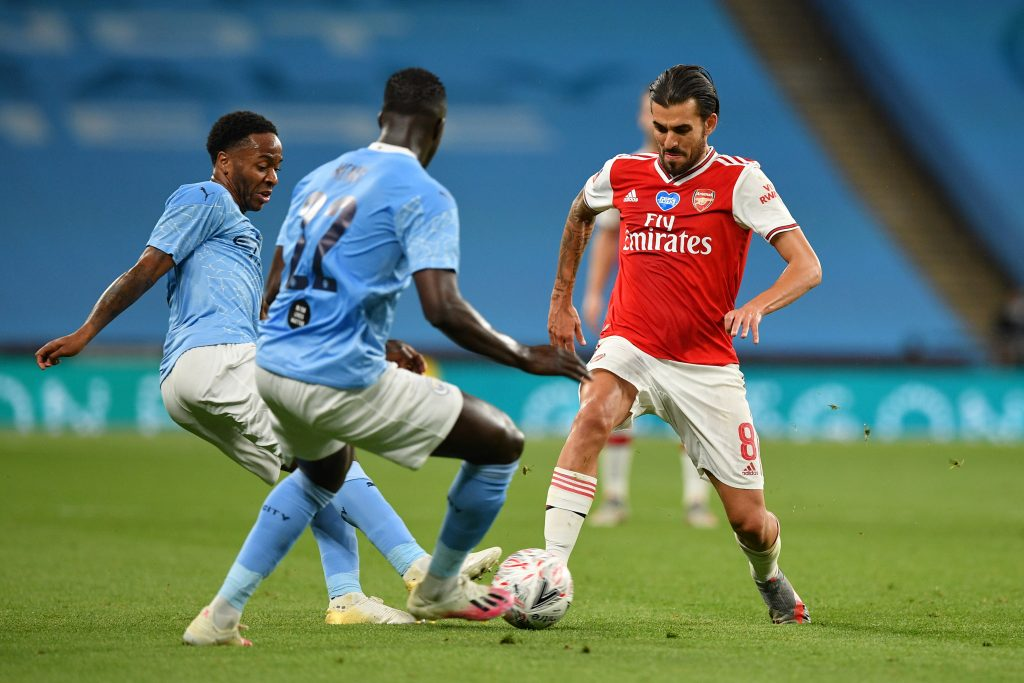 LONDON, ENGLAND - JULY 18: Dani Ceballos of Arsenal battles for possession with Raheem Sterling and Benjamin Mendy of Manchester City during the FA Cup Semi Final match between Arsenal and Manchester City at Wembley Stadium on July 18, 2020 in London, England. Football Stadiums around Europe remain empty due to the Coronavirus Pandemic as Government social distancing laws prohibit fans inside venues resulting in all fixtures being played behind closed doors. (Photo by Justin Tallis/Pool via Getty Images)