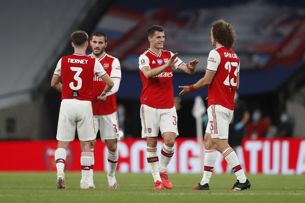 LONDON, ENGLAND - JULY 18: Granit Xhaka of Arsenal and David Luiz of Arsenal celebrate following the FA Cup Semi Final match between Arsenal and Manchester City at Wembley Stadium on July 18, 2020 in London, England. Football Stadiums around Europe remain empty due to the Coronavirus Pandemic as Government social distancing laws prohibit fans inside venues resulting in all fixtures being played behind closed doors. (Photo by Matthew Childs/Pool via Getty Images)