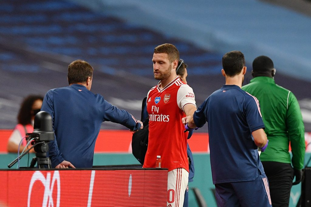 LONDON, ENGLAND - JULY 18: Shkodran Mustafi of Arsenal leaves the pitch injured during the FA Cup Semi Final match between Arsenal and Manchester City at Wembley Stadium on July 18, 2020 in London, England.(Photo by Justin Tallis/Pool via Getty Images)