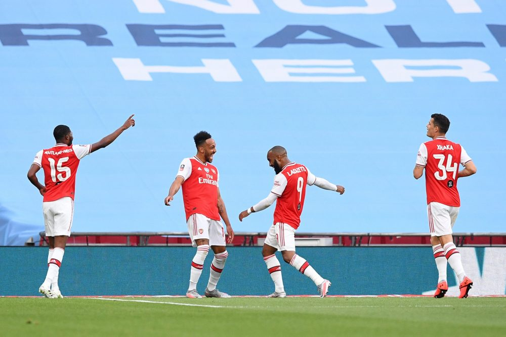 LONDON, ENGLAND - JULY 18: Pierre-Emerick Aubameyang of Arsenal celebrates with teammates after scoring his team's first goal during the FA Cup Semi Final match between Arsenal and Manchester City at Wembley Stadium on July 18, 2020 in London, England. Football Stadiums around Europe remain empty due to the Coronavirus Pandemic as Government social distancing laws prohibit fans inside venues resulting in all fixtures being played behind closed doors. (Photo by Justin Tallis/Pool via Getty Images)