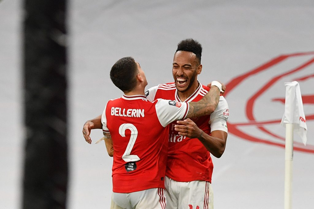 LONDON, ENGLAND - JULY 18: Pierre-Emerick Aubameyang of Arsenal celebrates with teammate Hector Bellerin after scoring his team's second goal during the FA Cup Semi Final match between Arsenal and Manchester City at Wembley Stadium on July 18, 2020 in London, England. Football Stadiums around Europe remain empty due to the Coronavirus Pandemic as Government social distancing laws prohibit fans inside venues resulting in all fixtures being played behind closed doors. (Photo by Justin Tallis/Pool via Getty Images)