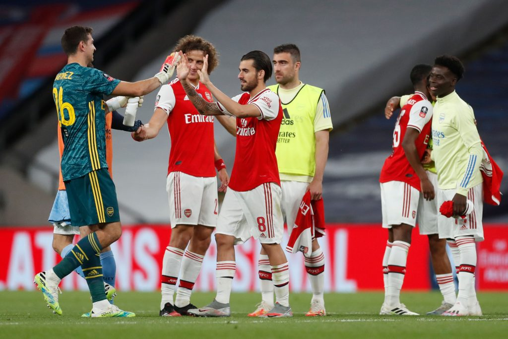 Arsenal's Argentinian goalkeeper Emiliano Martinez (L) celebrates with Arsenal's Brazilian defender David Luiz (2L) and Arsenal's Spanish midfielder Dani Ceballos (3L) at the end of the English FA Cup semi-final football match between Arsenal and Manchester City at Wembley Stadium in London, on July 18, 2020. (Photo by MATTHEW CHILDS / POOL / AFP)
