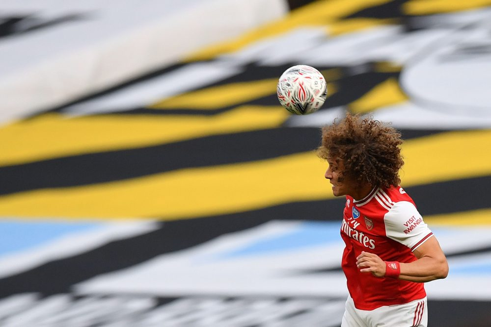 Arsenal's Brazilian defender David Luiz heads the ball during the English FA Cup semi-final football match between Arsenal and Manchester City at Wembley Stadium in London, on July 18, 2020. (Photo by JUSTIN TALLIS / POOL / AFP)