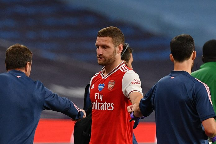 Arsenal's German defender Shkodran Mustafi (C) is helped off the pitch injured during the English FA Cup semi-final football match between Arsenal and Manchester City at Wembley Stadium in London, on July 18, 2020. (Photo by JUSTIN TALLIS / POOL / AFP) / NOT FOR MARKETING OR ADVERTISING USE / RESTRICTED TO EDITORIAL USE (Photo by JUSTIN TALLIS/POOL/AFP via Getty Images)