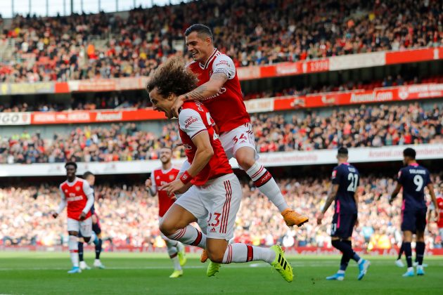 Asenal's Brazilian defender David Luiz (L) celebrates with Arsenal's Swiss midfielder Granit Xhaka after scoring the opening goal of the English Premier League football match between Arsenal and Bournemouth at the Emirates Stadium in London on October 6, 2019. (Photo by Tolga AKMEN / AFP)