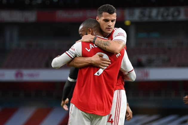 Arsenal's French striker Alexandre Lacazette (L) celebrates with Arsenal's Swiss midfielder Granit Xhaka (R) after scoring their first goal during the English Premier League football match between Arsenal and Liverpool at the Emirates Stadium in London on July 15, 2020. (Photo by Shaun Botterill / POOL / AFP)