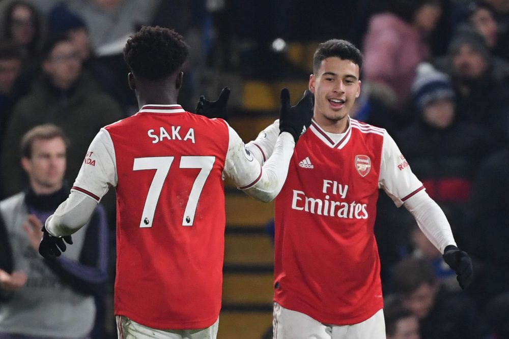 Arsenal's Brazilian striker Gabriel Martinelli (R) celebrates scoring their first goal to equalise 1-1 with Arsenal's English striker Bukayo Saka (L) during the English Premier League football match between Chelsea and Arsenal at Stamford Bridge in London on January 21, 2020. (Photo by DANIEL LEAL-OLIVAS / AFP)