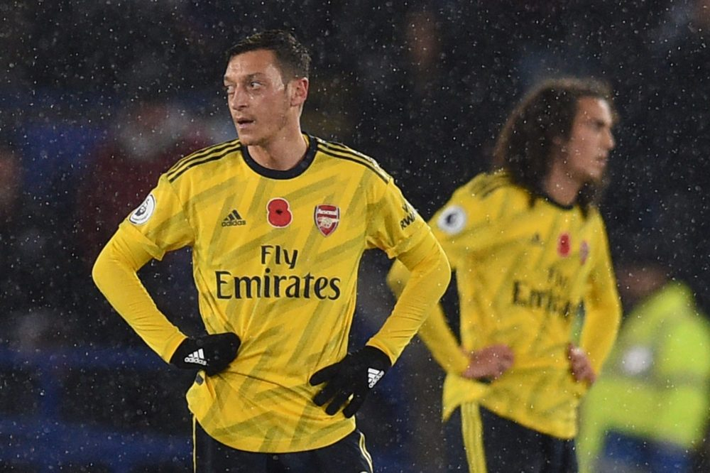 Arsenal's German midfielder Mesut Ozil (L) and Arsenal's French midfielder Matteo Guendouzi (R) reacts as they wait to restart after Leicester City score the opening goal during the English Premier League football match between Leicester City and Arsenal at King Power Stadium in Leicester, central England on November 9, 2019. (Photo by Oli SCARFF / AFP)
