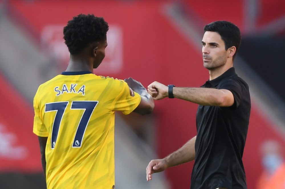 Arsenal's Spanish head coach Mikel Arteta (R) gestures with Arsenal's English striker Bukayo Saka at the final whistle during the English Premier League football match between Southampton and Arsenal at St Mary's Stadium in Southampton, southern England on June 25, 2020. (Photo by Mike Hewitt / POOL / AFP) / RESTRICTED TO EDITORIAL USE. No use with unauthorized audio, video, data, fixture lists, club/league logos or 'live' services. Online in-match use limited to 120 images. An additional 40 images may be used in extra time. No video emulation. Social media in-match use limited to 120 images. An additional 40 images may be used in extra time. No use in betting publications, games or single club/league/player publications. / (Photo by MIKE HEWITT/POOL/AFP via Getty Images)