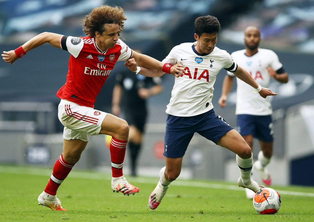 Tottenham Hotspur's South Korean striker Son Heung-Min (R) vies with Arsenal's Brazilian defender David Luiz during the English Premier League football match between Tottenham Hotspur and Arsenal at Tottenham Hotspur Stadium in London, on July 12, 2020. (Photo by Tim Goode / POOL / AFP) / RESTRICTED TO EDITORIAL USE. No use with unauthorized audio, video, data, fixture lists, club/league logos or 'live' services. Online in-match use limited to 120 images. An additional 40 images may be used in extra time. No video emulation. Social media in-match use limited to 120 images. An additional 40 images may be used in extra time. No use in betting publications, games or single club/league/player publications. /  (Photo by TIM GOODE/POOL/AFP via Getty Images)