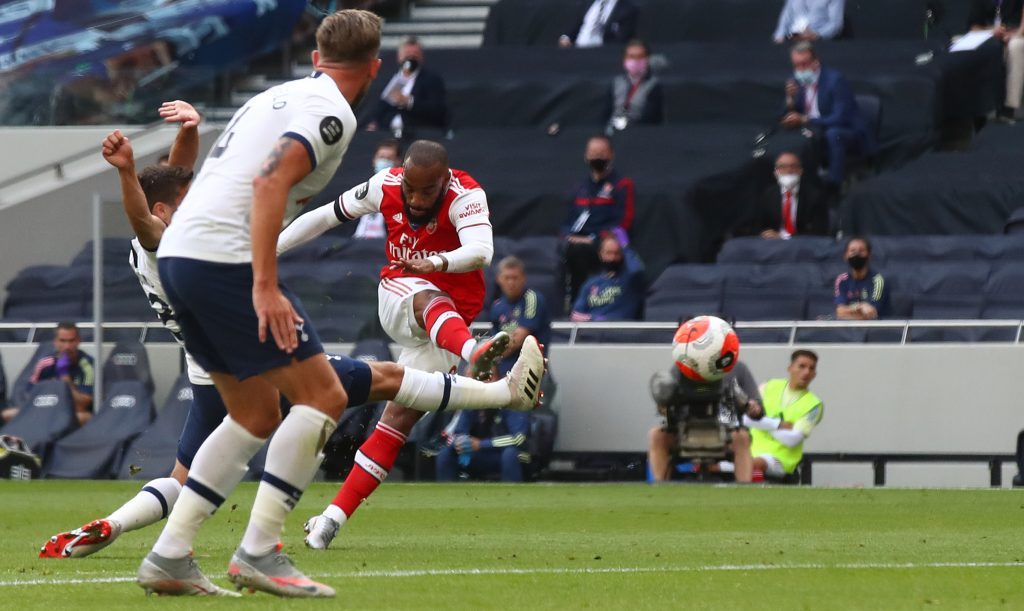 Arsenal's French striker Alexandre Lacazette shoots and scores during the English Premier League football match between Tottenham Hotspur and Arsenal at Tottenham Hotspur Stadium in London, on July 12, 2020. (Photo by Julian Finney / POOL / AFP) / RESTRICTED TO EDITORIAL USE. No use with unauthorized audio, video, data, fixture lists, club/league logos or 'live' services. Online in-match use limited to 120 images. An additional 40 images may be used in extra time. No video emulation. Social media in-match use limited to 120 images. An additional 40 images may be used in extra time. No use in betting publications, games or single club/league/player publications. /  (Photo by JULIAN FINNEY/POOL/AFP via Getty Images)