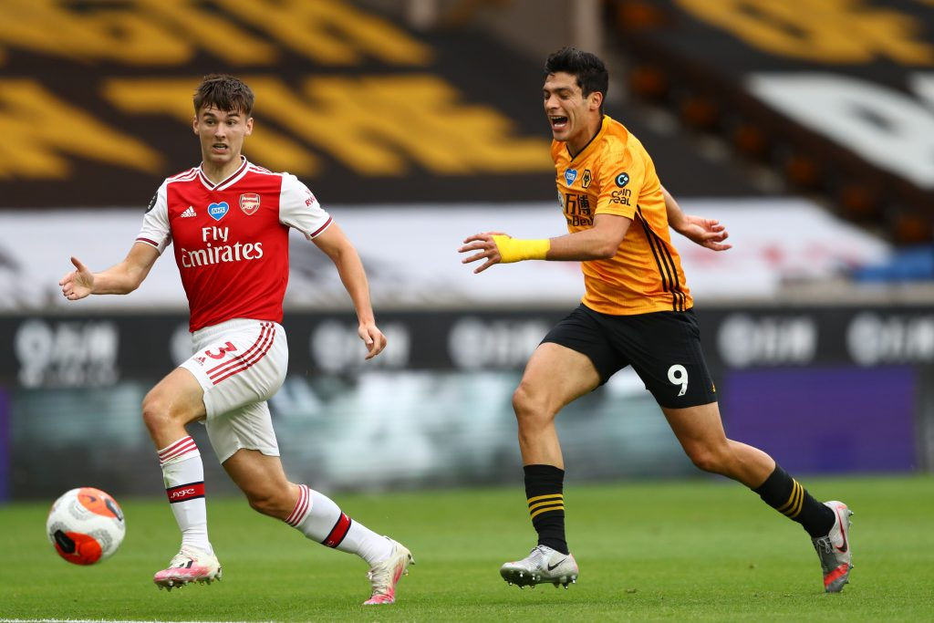 Wolverhampton Wanderers' Mexican striker Raul Jimenez (R) and Arsenal's Scottish defender Kieran Tierney (L) chase the ball during the English Premier League football match between Wolverhampton Wanderers and Arsenal at the Molineux stadium in Wolverhampton, central England on July 4, 2020. (Photo by Michael Steele / POOL / AFP) / RESTRICTED TO EDITORIAL USE. No use with unauthorized audio, video, data, fixture lists, club/league logos or 'live' services. Online in-match use limited to 120 images. An additional 40 images may be used in extra time. No video emulation. Social media in-match use limited to 120 images. An additional 40 images may be used in extra time. No use in betting publications, games or single club/league/player publications. / (Photo by MICHAEL STEELE/POOL/AFP via Getty Images)