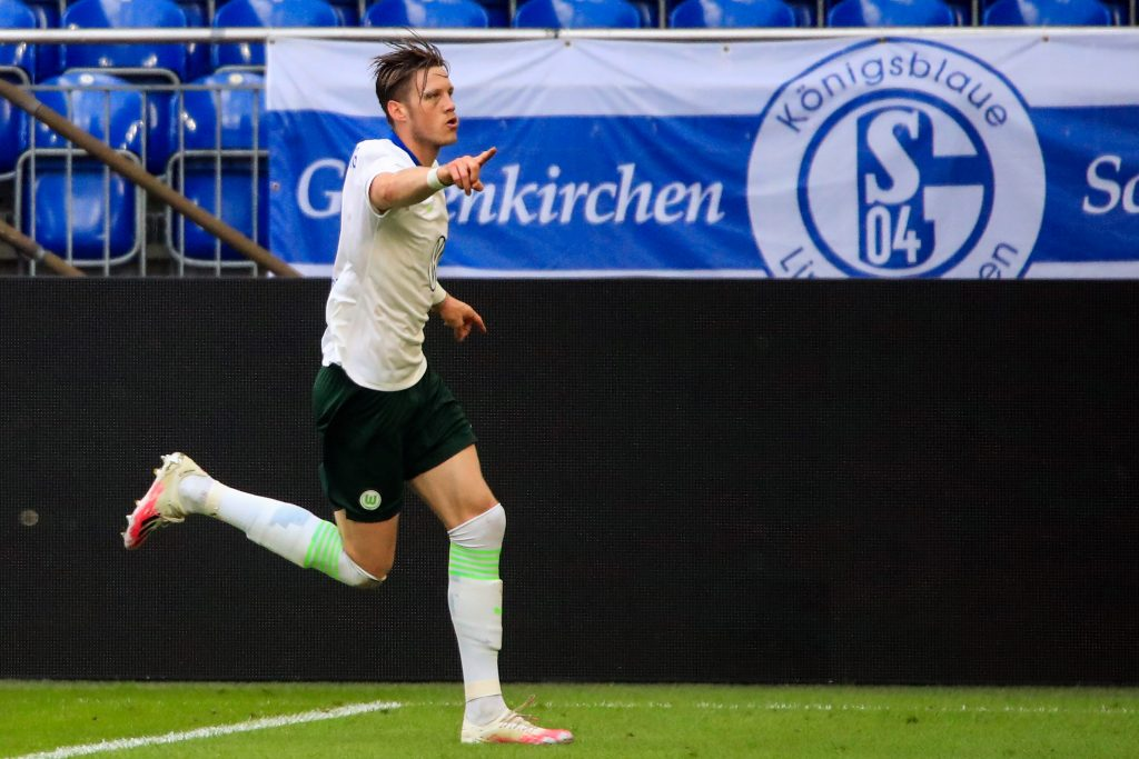 Wolfsburg's Dutch forward Wout Weghorst celebrates after scoring a goal during the German first division Bundesliga football match Schalke 04 v VfL Wolfsburg on June 20, 2020 in Gelsenkirchen, western Germany. (Photo by WOLFGANG RATTAY / POOL / AFP) / DFL REGULATIONS PROHIBIT ANY USE OF PHOTOGRAPHS AS IMAGE SEQUENCES AND/OR QUASI-VIDEO (Photo by WOLFGANG RATTAY/POOL/AFP via Getty Images)