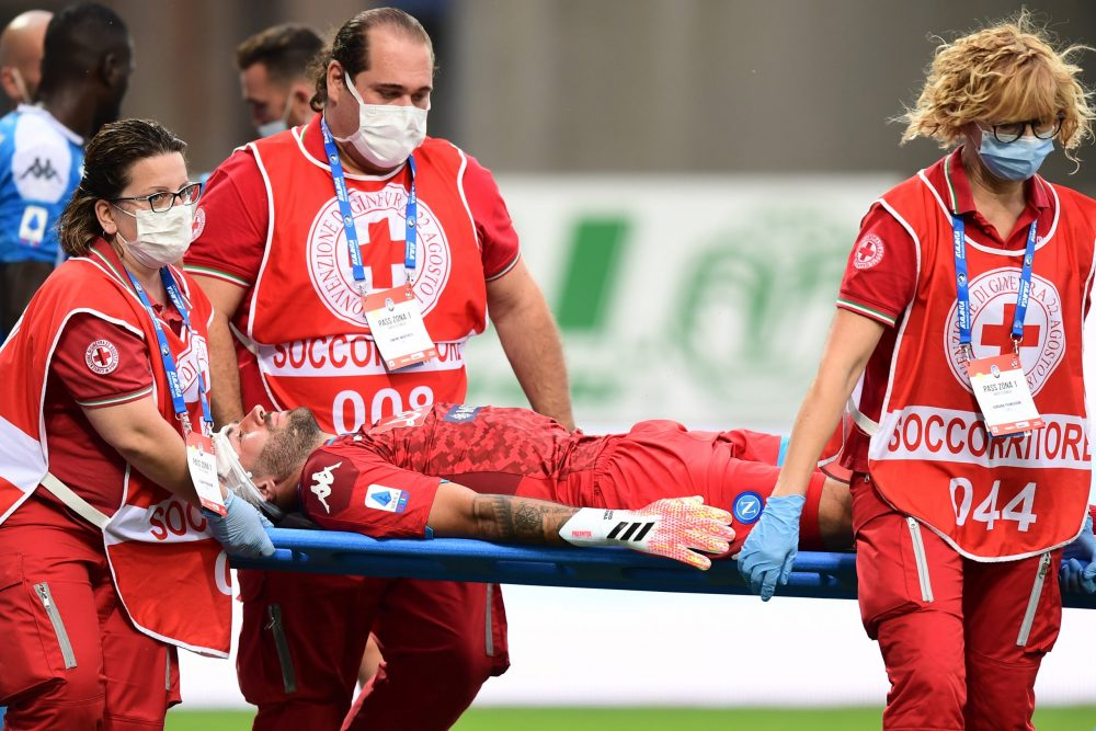 Napoli's Colombian goalkeeper David Ospina is stretched out of the pitch following a head injury during the Italian Serie A football match Atalanta vs Napoli played on July 2, 2020 behind closed doors at the Atleti Azzurri d'Italia stadium in Bergamo, as the country eases its lockdown aimed at curbing the spread of the COVID-19 infection, caused by the novel coronavirus. (Photo by Miguel MEDINA / AFP) (Photo by MIGUEL MEDINA/AFP via Getty Images)