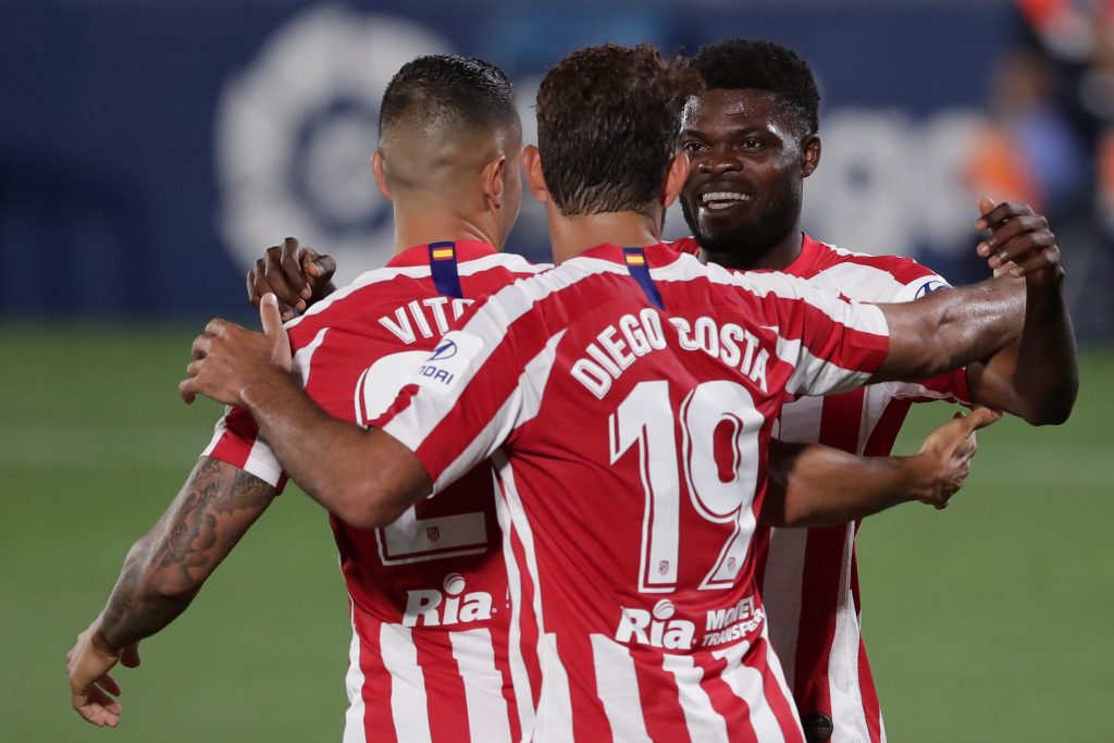 GETAFE, SPAIN - JULY 16: Thomas Teye Partey (R) of Atletico de Madrid celebrates scoring their second goal with teammate Diego Costa (2ndL) and Victor Machin alias Vitolo (L) during the Liga match between Getafe CF and Club Atletico de Madrid at Coliseum Alfonso Perez on July 16, 2020 in Getafe, Spain. (Photo by Gonzalo Arroyo Moreno/Getty Images)
