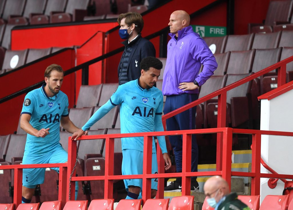 SHEFFIELD, ENGLAND - JULY 02: Harry Kane and Dele Alli of Tottenham Hotspur walk into the stands after the Premier League match between Sheffield United and Tottenham Hotspur at Bramall Lane on July 02, 2020 in Sheffield, England. Football Stadiums around Europe remain empty due to the Coronavirus Pandemic as Government social distancing laws prohibit fans inside venues resulting in all fixtures being played behind closed doors. (Photo by Michael Regan/Getty Images)