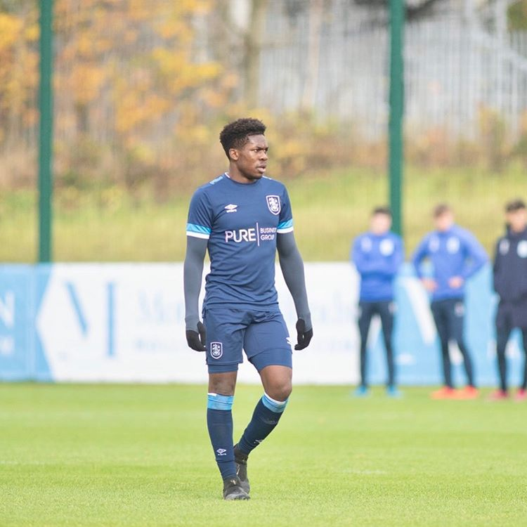 Tim Akinola with Huddersfield Town (Photo via Akinola on Instagram)