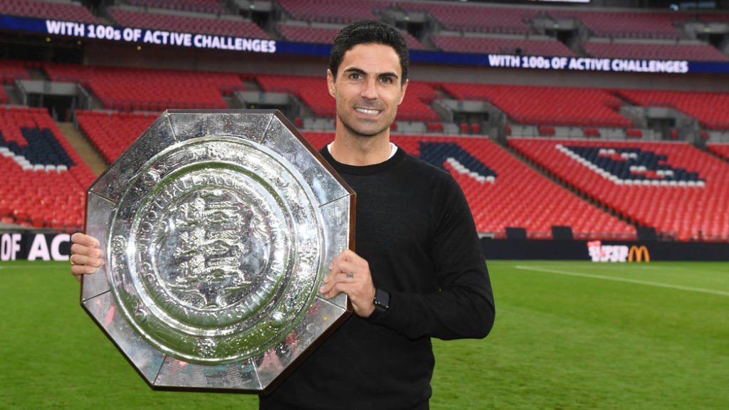 LONDON, ENGLAND - AUGUST 29: Arsenal Head Coach Mikel Arteta with the Community Shield after the FA Community Shield match between Arsenal and Liverpool at Wembley Stadium on August 29, 2020 in London, England. (Photo by Stuart MacFarlane/Arsenal FC via Getty Images)