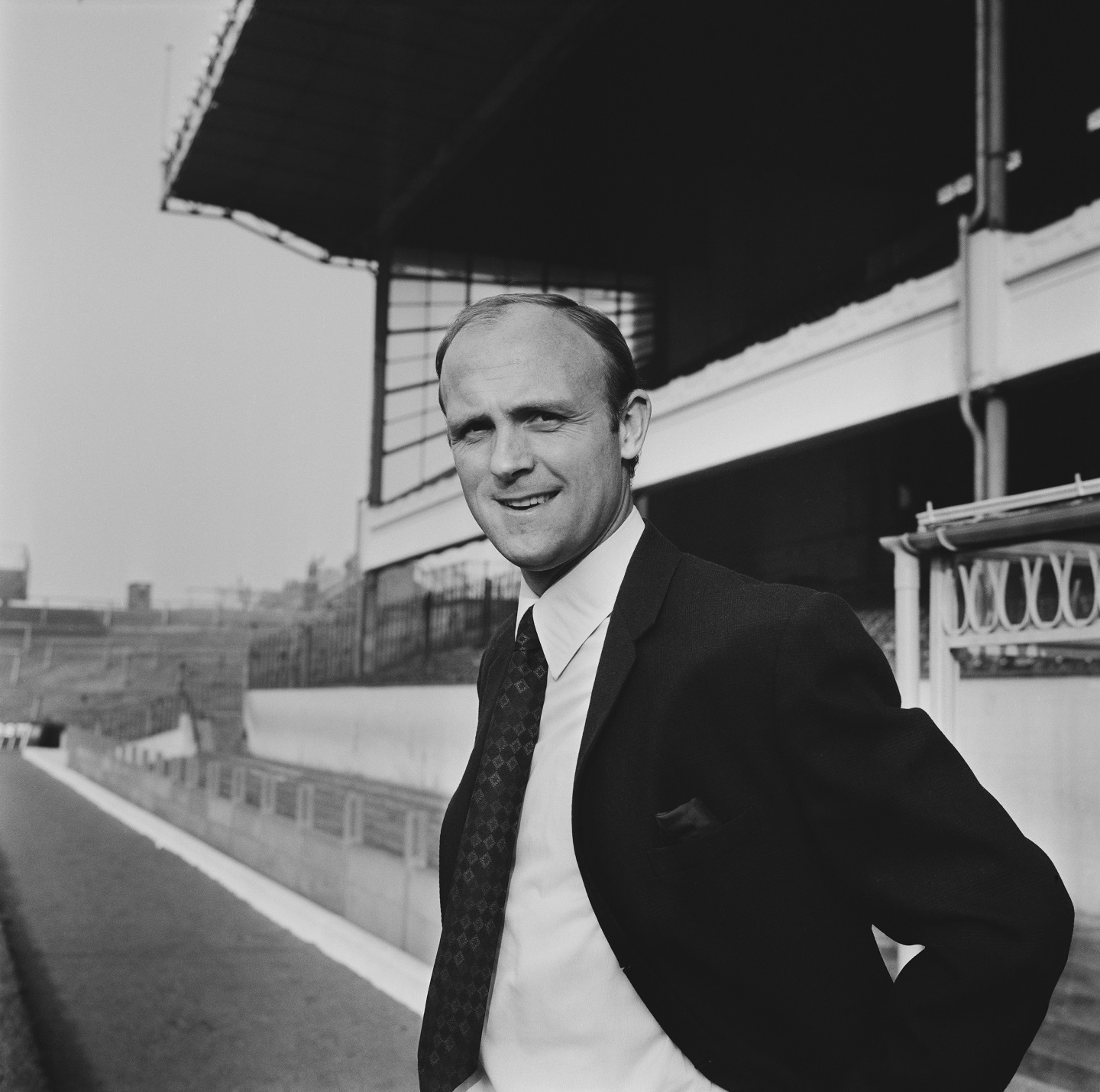English former footballer and team coach of Arsenal Football Club, Don Howe (1935-2015) pictured standing beside the pitch at the club's Highbury Stadium in North London on 14th December 1970. (Photo by Dove/Daily Express/Hulton Archive/Getty Images)