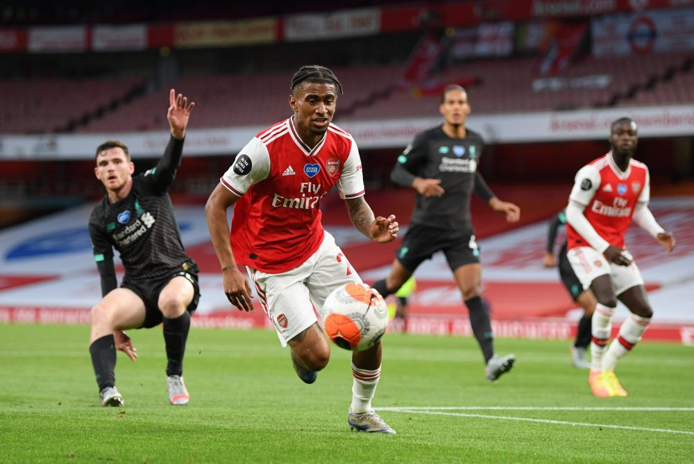 LONDON, ENGLAND - JULY 15:  Reiss Nelson of Arsenal in action during the Premier League match between Arsenal FC and Liverpool FC at Emirates Stadium on July 15, 2020 in London, England. Football Stadiums around Europe remain empty due to the Coronavirus Pandemic as Government social distancing laws prohibit fans inside venues resulting in all fixtures being played behind closed doors. (Photo by Shaun Botterill/Getty Images)
