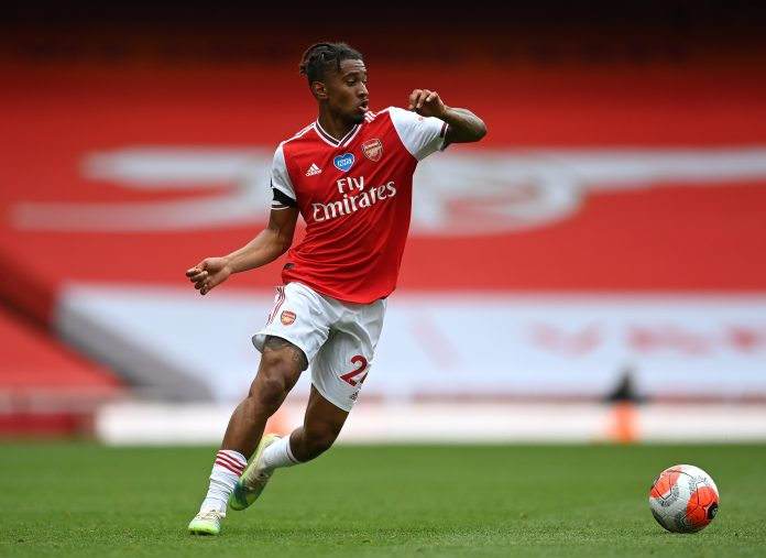 LONDON, ENGLAND - JULY 01: Reiss Nelson of Arsenal runs with the ball during the Premier League match between Arsenal FC and Norwich City at Emirates Stadium on July 01, 2020 in London, England. (Photo by Shaun Botterill/Getty Images)