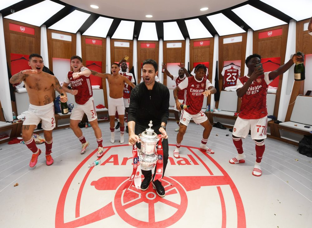Mikel Arteta and Arsenal players celebrate in Wembley dressing room (via Arsenal.com)
