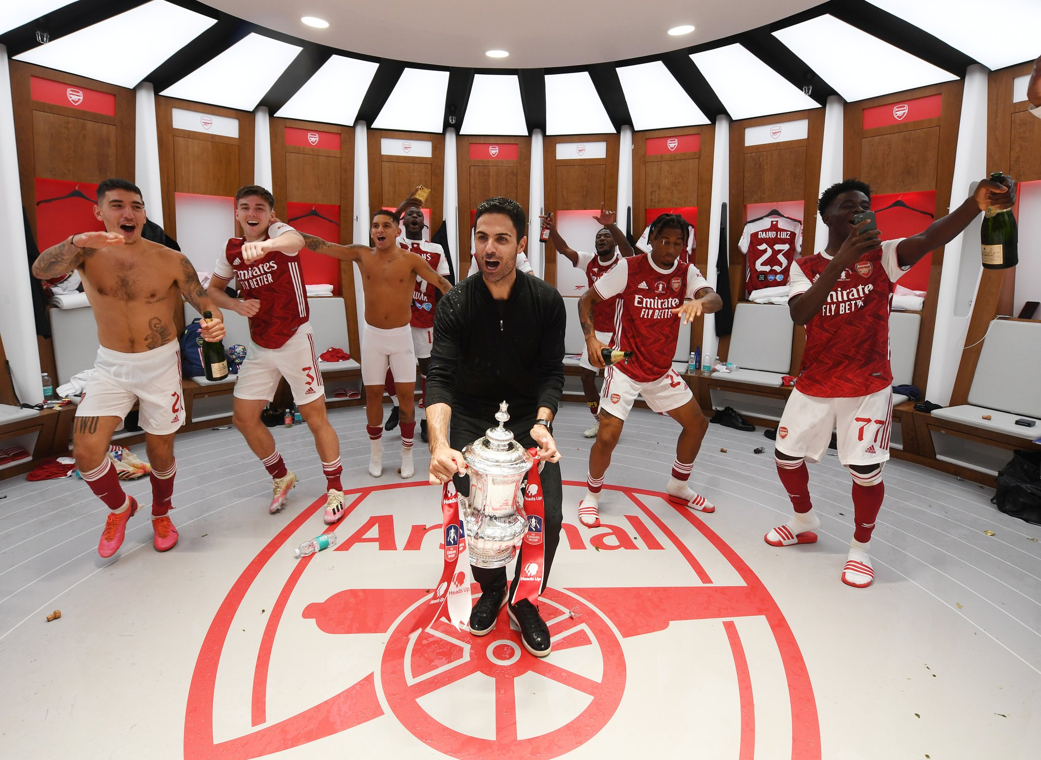 Mikel Arteta and Arsenal players celebrate in Wembley dressing room(via Arsenal.com)