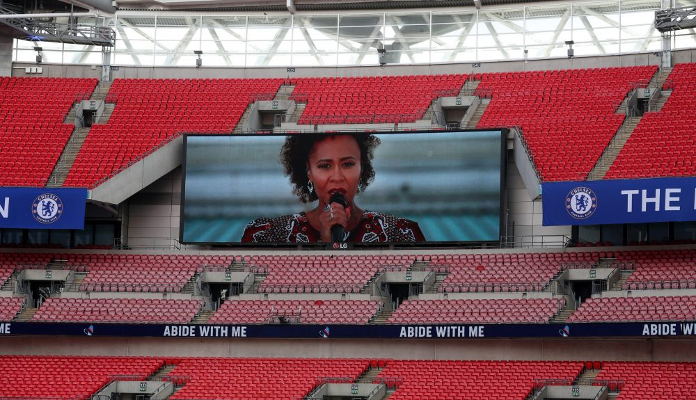 LONDON, ENGLAND - AUGUST 01: Singer Emeli Sande sings on a pre recorded video on the big screen during the Heads Up FA Cup Final match between Arsenal and Chelsea at Wembley Stadium on August 01, 2020 in London, England. Football Stadiums around Europe remain empty due to the Coronavirus Pandemic as Government social distancing laws prohibit fans inside venues resulting in all fixtures being played behind closed doors. (Photo by Catherine Ivill/Getty Images)
