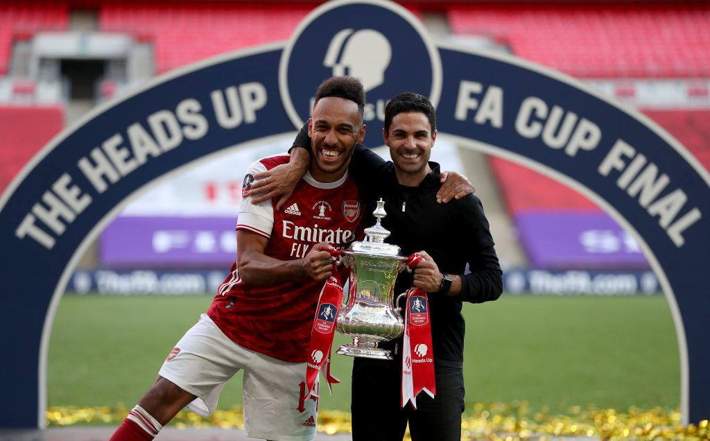 LONDON, ENGLAND - AUGUST 01: Pierre-Emerick Aubameyang of Arsenal poses with Mikel Arteta, Manager of Arsenal and the FA Cup Trophy after their teams victory in the Heads Up FA Cup Final match between Arsenal and Chelsea at Wembley Stadium on August 01, 2020 in London, England. Football Stadiums around Europe remain empty due to the Coronavirus Pandemic as Government social distancing laws prohibit fans inside venues resulting in all fixtures being played behind closed doors. (Photo by Catherine Ivill/Getty Images)