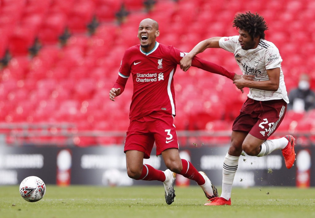 LONDON, ENGLAND: Fabinho of Liverpool battles for possession with Mohamed Elneny of Arsenal during the FA Community Shield final between Arsenal and Liverpool at Wembley Stadium on August 29, 2020. (Photo by Andrew Couldridge/Pool via Getty Images)