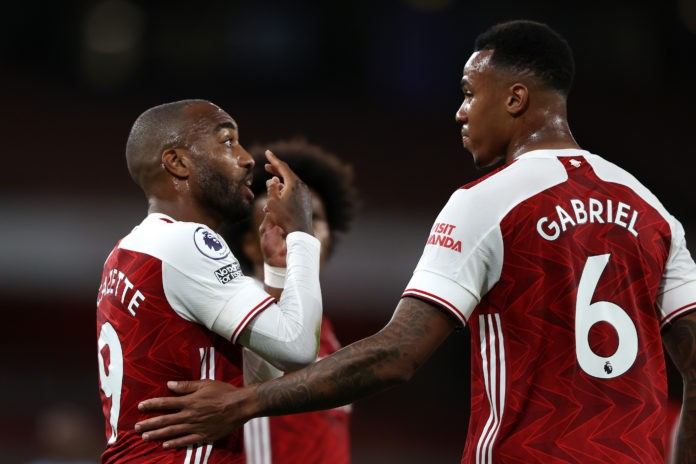 LONDON, ENGLAND - SEPTEMBER 19: Alexandre Lacazette of Arsenal celebrates with teammate Gabriel after scoring his team's first goal during the Premier League match between Arsenal and West Ham United at Emirates Stadium on September 19, 2020 in London, England. (Photo by Ian Walton - Pool/Getty Images)